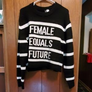 Long sleeve, long crop length sweater.